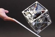 This robotic cube can balance on its edge, stand on a corner and even walk